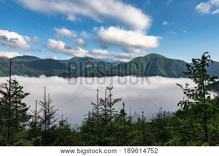 Fog In Mountain Valley, Mountain Ridge And Blue Sky