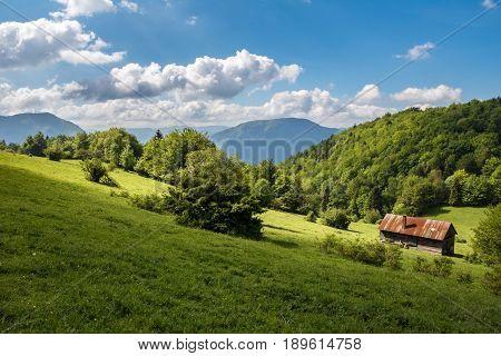 Farmers Chalet On Hillside Pasture