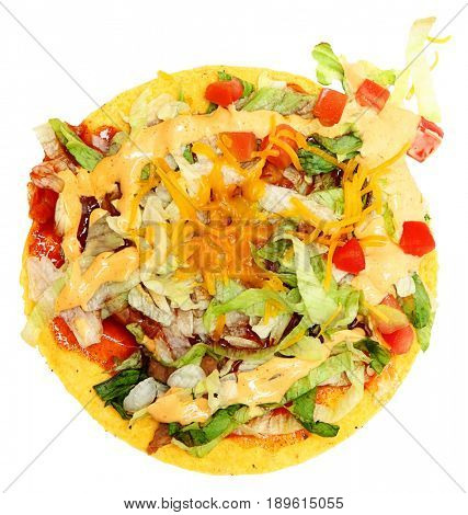 Spicy Tostada with Chippotle sauce, refried beans, lettuce, tomato, red sauce over white.