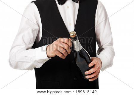 Closeup of a waiter uncorking a bottle of champagne