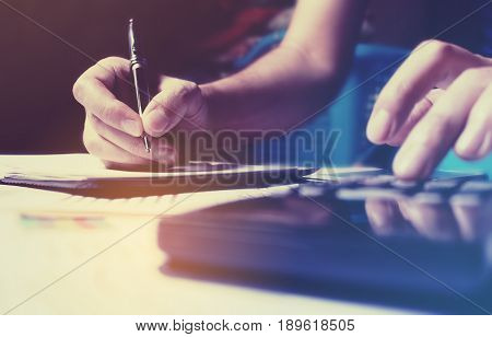 Finance Savings Concept With Woman Hand Writing Make Note And Calculate Doing Finance At Home Office