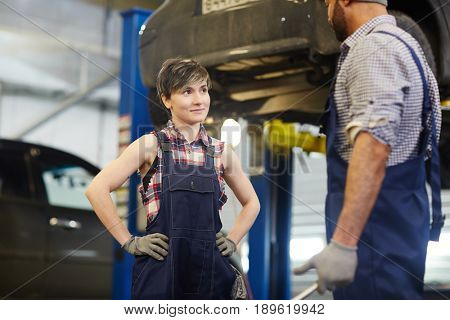 Trainee of car-service mechanic listening to his recommendations