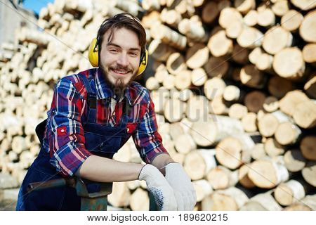 Happy tree-service worker looking at camera