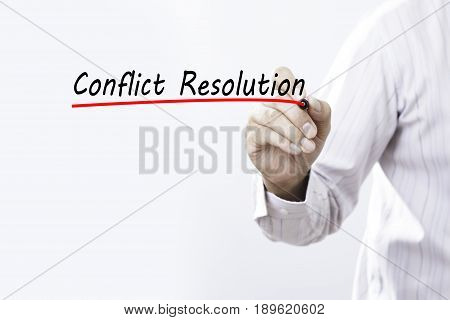 Businessman hand writing Conflict Resolution. Business concept.