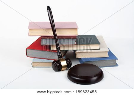 Law concept open book with wooden judges gavel on table in a courtroom or law enforcement office, white background. Copy space for text