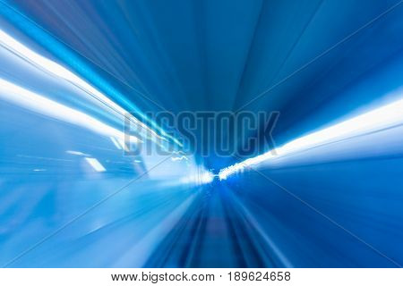 Moving of the train and light trail in tunnel. Underground light.
