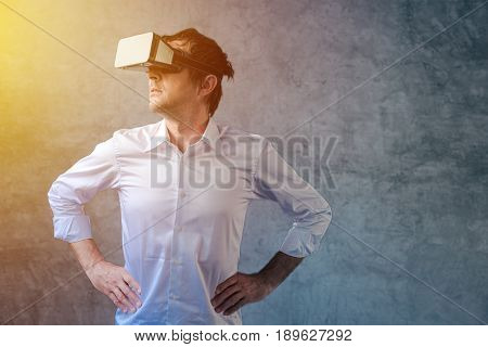 Adult businessman with VR goggles headset interactive immersive futuristic technology poster