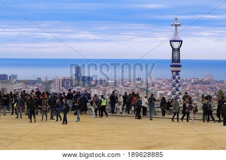 Barcelona Spain - 1 April 2017: Beautiful cloudy view of crowded Park Guell.