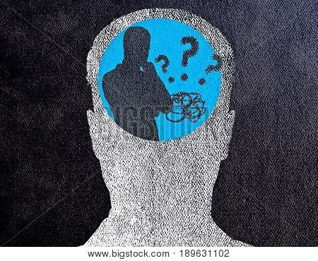 Abstract concrete head with thoughtful person inside. Confusion concept