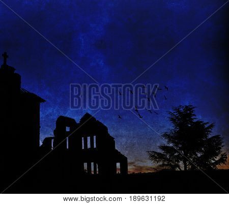 Silhouette of an abandoned orphanage, tree and flock of birds at dusk. Grunge textured image with copy space.