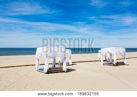 The wooden veranda on a beach in summer