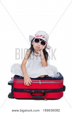 Asian Little Chinese Girl Sitting On A Suitcase