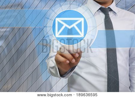 Hand of businessman use finger touch icon of envelope or e-mail system for idea presentation in your organization and work.
