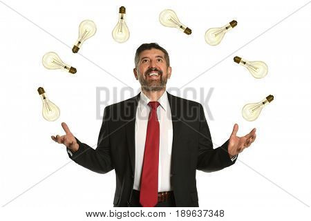 Hispanic businessman juggling multiple lightbulbs isolated over white background