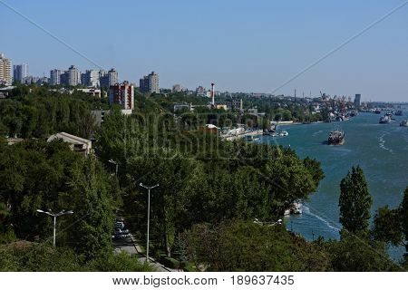 ROSTOV-ON-DON, RUSSIA - SEPTEMBER 28, 2015: Cityscape and fright transportation on the river Don. Port Rostov-on-Don is the largest transit point in the South of Russia