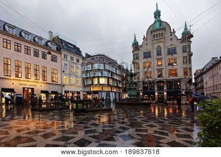 COPENHAGEN, DENMARK - NOVEMBER 5, 2016: People walking at the Stork Fountain on Amagertorv square. The fountain erected in 1894 by design of  Edvard Petersen and Vilhelm Bissen