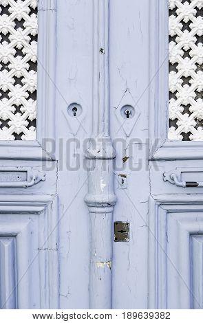 Old Door Decorated In Blue