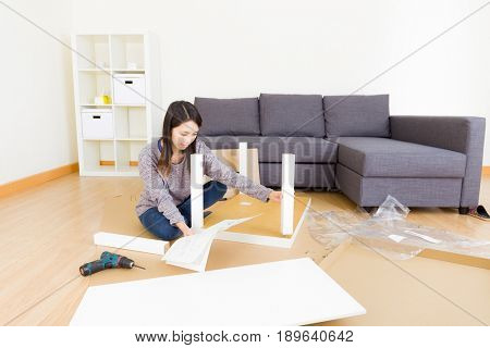 Woman assembling cupboard