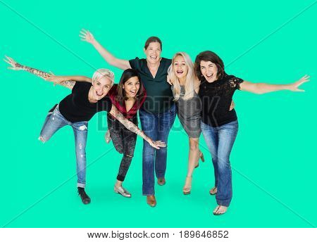 Happiness group of women arms stretched and huddle playful