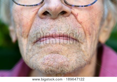 Lower Face Of An Old Man With Stubble