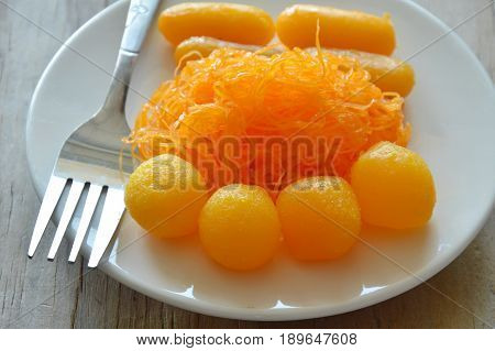 golden threads and bean paste with egg yolk fudge balls cooked in syrup variety Thai sweetmeat on dish