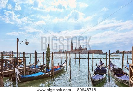 Grand canal in Venice, Piazza San Marco, in the background the island San Giorgio. Beautiful moody cityscape with gondolas