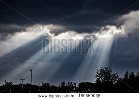 Sun Rays falling through the Clouds .