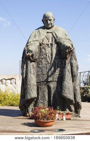 LORETO, ITALY - AUGUST 8, 2010: Monument of Papa Giovanni XXIII in the square of Loreto, Marche, Italy