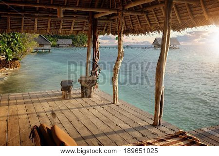 beachhouse with sundown and blue water in asia