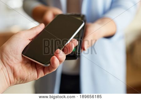 Man Paying With Nfc Technology On Mobile Phone