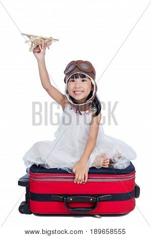 Happy Asian Little Chinese Girl Playing With Toy Airplane