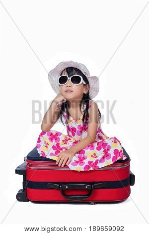 Happy Asian Little Chinese Girl Sitting On A Suitcase