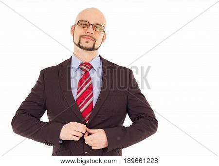 Handsome man in suit with red tie showing determintaion.
