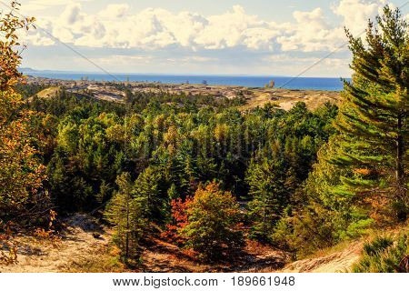 Lake Michigan Coastal Dune Panorama. Forested freshwater coastal dune ecosystem on the shore of Lake Michigan. The Great Lakes have the largest freshwater dune ecosystem in the world along their coast