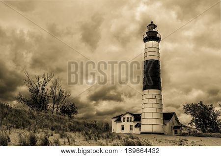 Historical Michigan Lighthouse. The Big Sable Lighthouse has stood on the shores of Lake Michigan for over a century and is now the centerpiece of Ludington State Park.