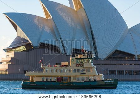 Sydney Australia - July 23: Ferry boat in Circular Quay with Sydney Opera House on the background. Sydney public water transport infrastructure