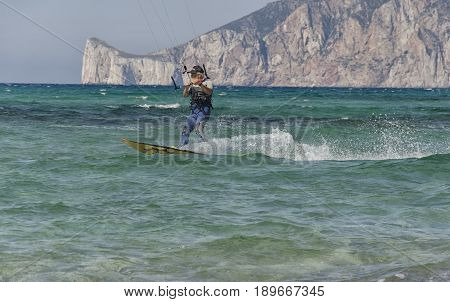 Porto Paglia Italy - October 03 2016: Aged person keeps active by practicing kitesurf