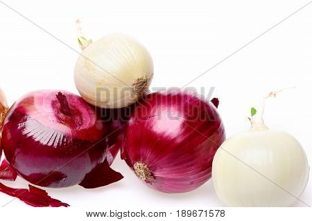 Group Of Red And White Onions Lying On Each Other