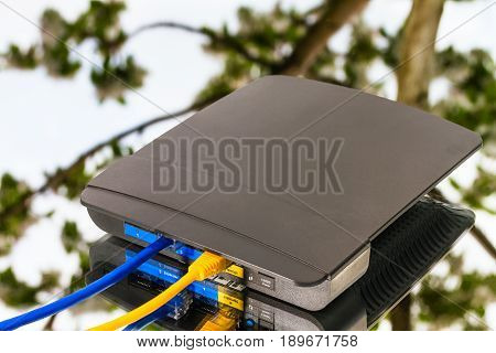 Wireless Router, Yellow And Blue Ethernet Cables