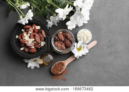 Beautiful composition with cocoa butter lotion and ingredients on table