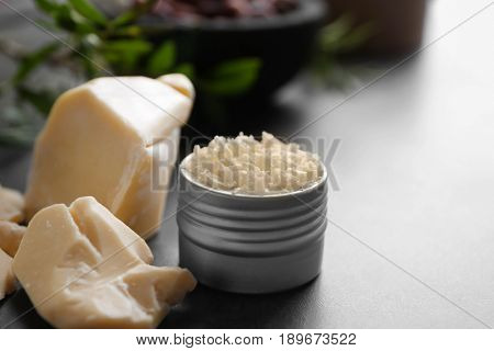 Jar with cocoa butter product on table