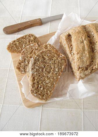 Slices of whole grain bread on wooden board