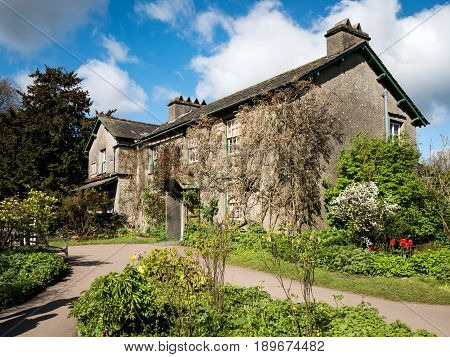 NEAR SAWREY UK - 23 APRIL 2017: The quaint English country cottage known as Hill Top in the Lake District village of Near Sawrey. The house was once the home of children's author Beatrix Potter.