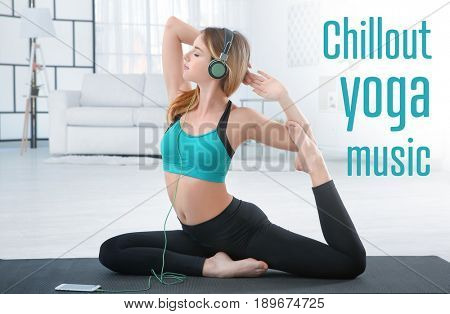 Young woman listening to music during yoga practice at home. Concept of melody for meditation