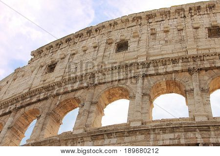 Rome, Italy - May 14, 2017: Colosseum (Flavian amphitheater) - a monument of architecture of Ancient Rome, the most famous and one of the most grandiose structures of the Ancient World, preserved to our time.