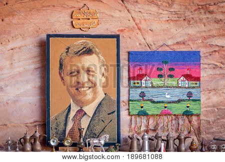 PETRA, JORDAN. May 1, 2014. Carpet with a portrait of Jordanian king Abdullah II in a souvenir shop in the Petra historical and archaeological park.