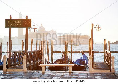 Venice Italy - scenic view of gondolas and grand canal on background Saint Mark square