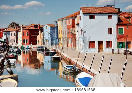 Burano Venice Italy - colorful buildings and boats in the canal