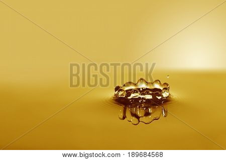 Nice abstract yellow water splash on gradient background