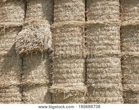 Closeup of stacked round straw bales